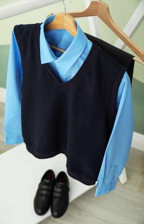 School uniform for boy on rack indoors