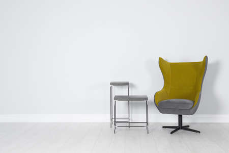 Elegant room interior with stylish comfortable armchair Stock Photo