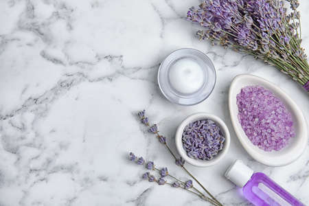 Flat lay composition with lavender flowers and natural cosmetic products on marble background