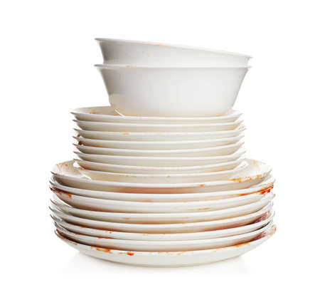 Pile of dirty dishes on white background Imagens