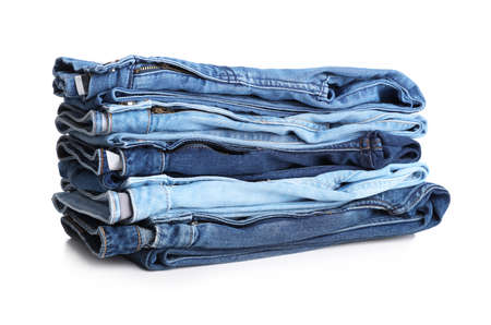 Stack of stylish jeans on white background