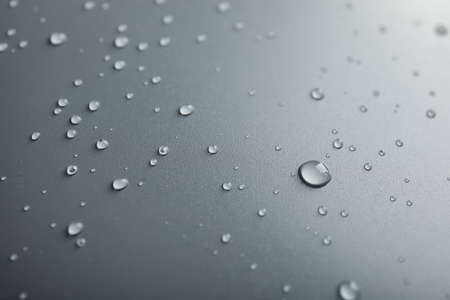Many clean water drops on grey background Banco de Imagens
