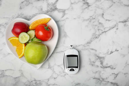 Flat lay composition with digital glucometer, fruits and vegetables on table. Diabetes concept Stock Photo