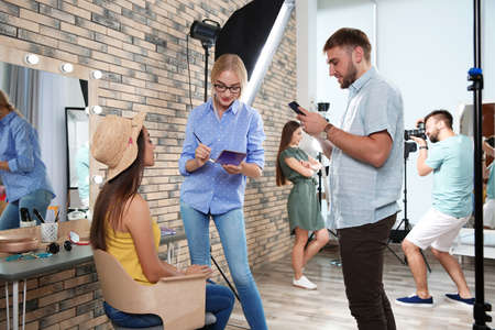 Professional team working with model in photo studio Stock Photo