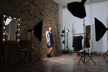 Beautiful young woman in photo studio