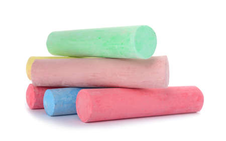 Color pieces of chalk on white background