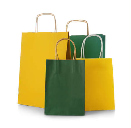 Mockup of paper shopping bags on white background