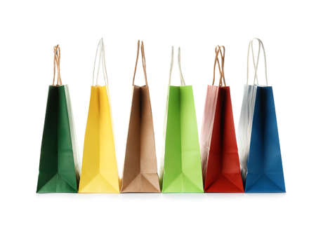 Empty paper shopping bags on white background
