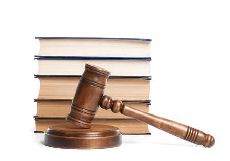Wooden gavel and books on white background. Law concept Banco de Imagens