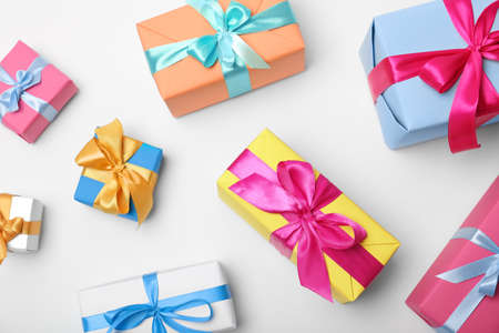 Flat lay composition with beautiful gift boxes on white background Stock Photo