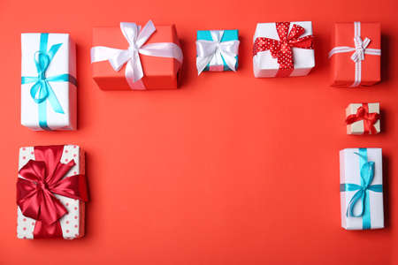 Flat lay composition with gift boxes on color background
