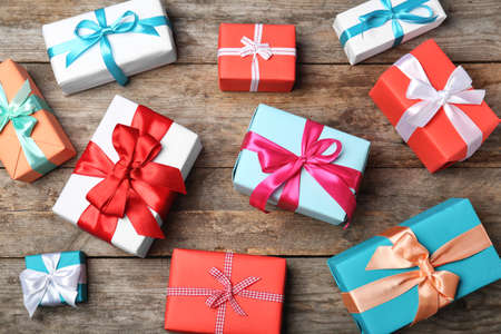 Flat lay composition with beautiful gift boxes on wooden background Stock Photo