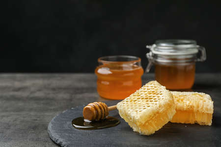 Slate plate with fresh honeycombs on table Stock Photo