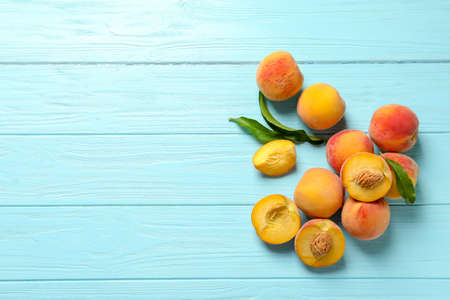 Fresh sweet peaches on wooden table, top view Stock Photo