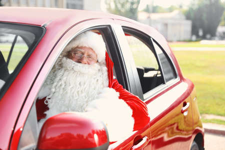 Authentic Santa Claus in car, view from outside