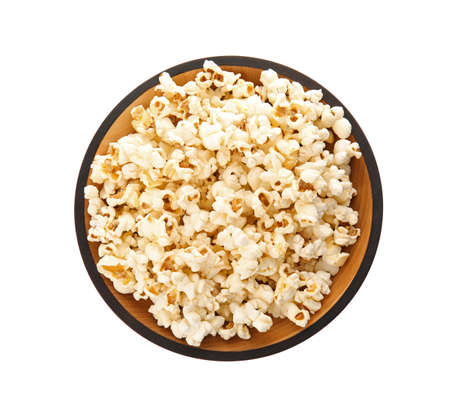 Bowl of tasty popcorn on white background, top view