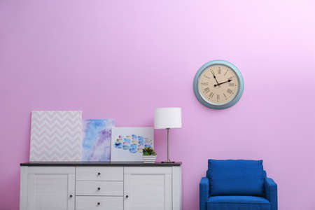 Room interior with stylish clock on wall. Time of day Archivio Fotografico
