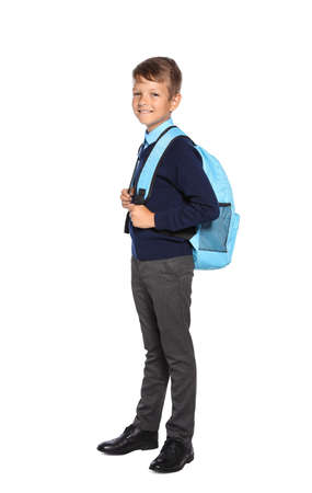 Little boy in stylish school uniform on white background