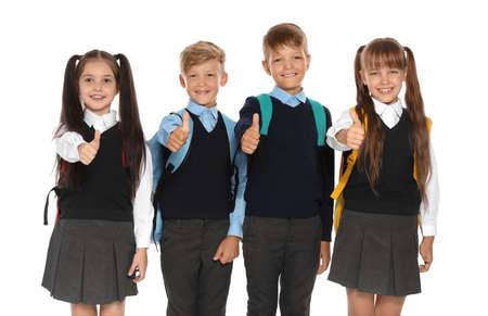 Little children in stylish school uniform on white background Stock Photo