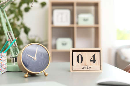 Stylish alarm clock on table in office. Time to work 스톡 콘텐츠