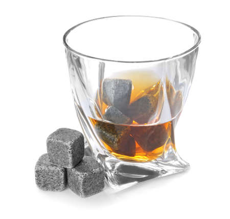 Glass with liquor and whiskey stones on white background Imagens