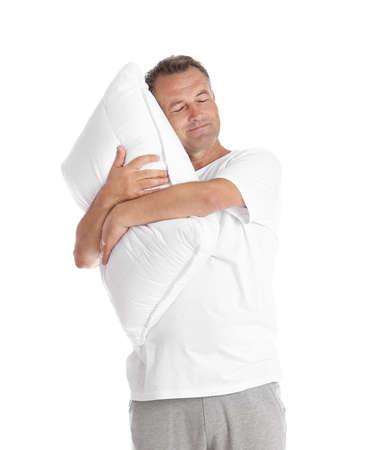 Man holding soft pillow on white background Stock Photo