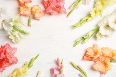 Flat lay composition with beautiful gladiolus flowers on wooden background Stock fotó - 106484184