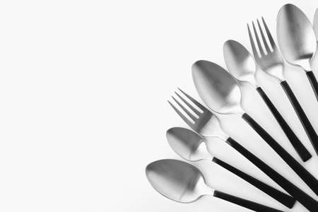 Forks and spoons on white background. New cutlery Stock Photo