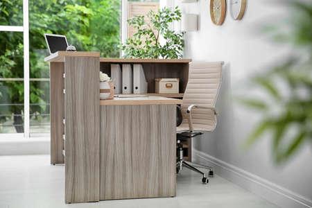 Receptionist desk in hotel. Workplace interior Banco de Imagens