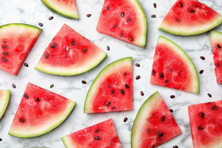 Flat lay composition with watermelon slices on marble background Archivio Fotografico