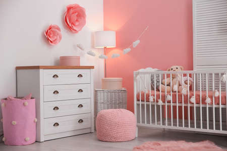 Baby room interior with decorations and comfortable crib