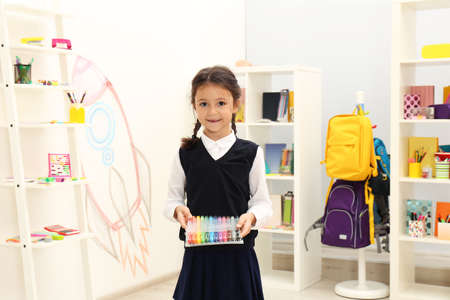 Cute child choosing school stationery in store