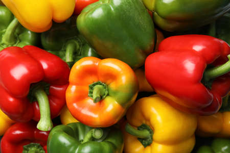 Colorful paprika peppers as background, closeup