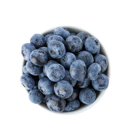 Bowl full of fresh ripe blueberries on white background, top view Фото со стока