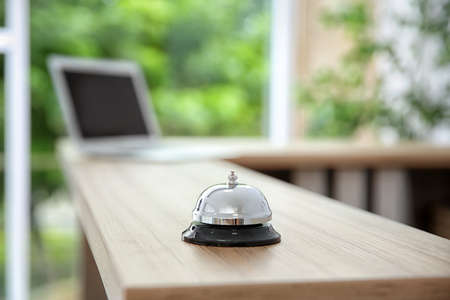 Service bell on reception desk in hotel, closeup