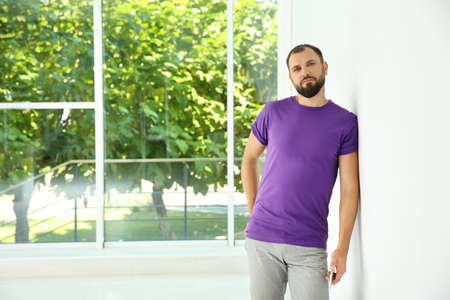 Portrait of man in casual clothes indoors