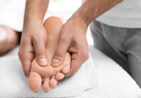 Young woman receiving massage in salon, closeup Standard-Bild