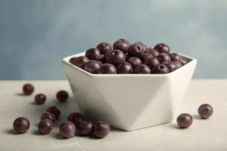 Bowl with fresh acai berries on table, closeup Stock Photo