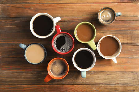 Flat lay composition with cups of coffee on wooden background. Food photography Stock Photo
