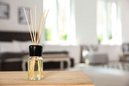 Aromatic reed air freshener on table indoors