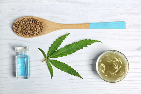 Flat lay composition with hemp lotion on wooden background 免版税图像 - 107175745