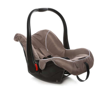 Brown child safety seat on white background