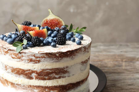 Delicious homemade cake with fresh berries on wooden table, closeup
