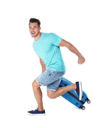 Young man running with suitcase on white background Stock Photo