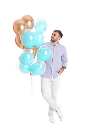 Young man with air balloons on white background