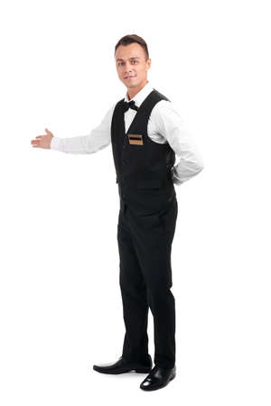 Full length portrait of young waiter in uniform on white background