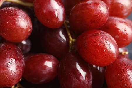 Bunch of red fresh ripe juicy grapes as background. Closeup view