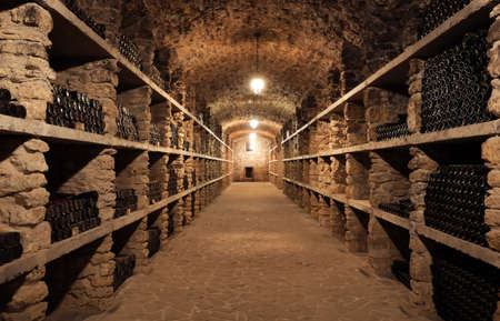 Wine cellar interior with many bottles on shelves