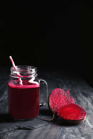 Mason jar of beet smoothie on table, space for text Archivio Fotografico