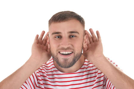 Young man with hearing problem on white background